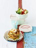 Bulgur pancakes with harissa yoghurt & tomato & cucumber salad