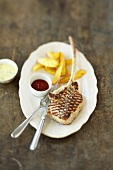 Grilled veal chop with chips, home-made ketchup