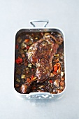 Braised shoulder of lamb in a roasting tin