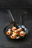 Polenta rounds with tomato sauce, cheese and herbs
