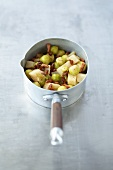 Brussels sprouts with celeriac and bacon in a pan