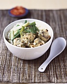 Green chicken curry with spring onions and coriander
