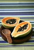 Halved papaya with spoon