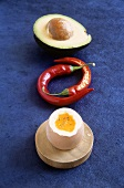 Ingredients for Ayurvedic cooking: egg, chili, avocado