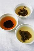 Three bowls of different types of tea