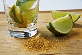 Ingredients for caipirinha: limes and brown sugar
