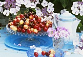 Various types of cherries on a cake stand