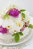 Wedding cake with roses and orchids