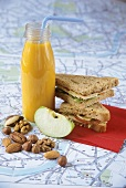 Cheese sandwiches, breakfast juice, apple and nuts