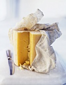 Ripe Cheddar cheese with muslin cloth