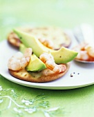Shrimps and avocado on crackers