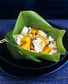 Fish and pumpkin curry with chilli in a banana leaf