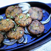 Vegetable burgers with onions and coriander leaves