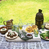 Picnic with savoury dishes (cheese, falafel, tarts)