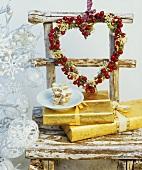 Cinnamon stars, Christmas gifts & wreath of holly berries