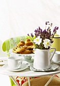 Breakfast table with jug of lavender
