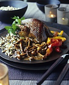 Roast quail with wild rice, mushrooms, peppers