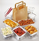 Take-away food: several dishes in aluminium containers