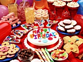 Birthday cake, sweets etc. on party buffet