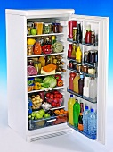 Tall refrigerator filled with food
