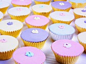 Muffins with pastel-coloured decorations