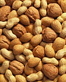 Unshelled peanuts, walnuts and almonds (full-frame)