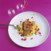 Duck with vegetable rice and pomegranate sauce