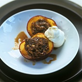 Baked peach halves with almond and biscuit stuffing