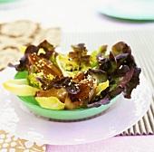 Caramelised shallots on oak leaf lettuce