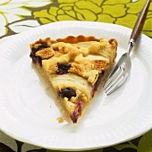 A piece of pear and blueberry pie