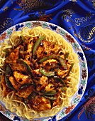 Chicken with black beans on Chinese egg noodles