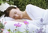 Young woman asleep in garden