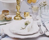 White place-setting on table laid for special occasion