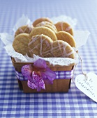 Heart-shaped biscuits in small basket with Valentine gift tag
