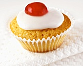 Iced cupcake with cherry