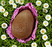 Chocolate egg with the words 'Happy Easter' in grass