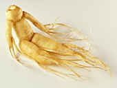 A ginseng root on a light background