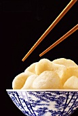 Chopsticks over a bowl of prawn crackers