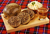 Haggis served with mashed turnips & a glass of whisky (Scotland)