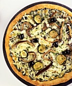 Vegetable pizza with aubergines, courgettes, olives & cheese
