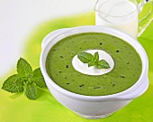 Green pea soup with cream and mint