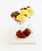 Low-fat mango ice cream with fresh strawberries