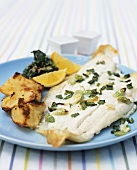 Plaice fillet with potatoes, spinach and mushrooms