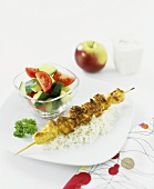Chicken kebab with rice and tomato & cucumber salad