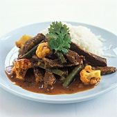 Beef curry with cauliflower, beans and rice