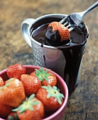 Dipping strawberry in melted chocolate