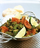 Okra with tomatoes and limes