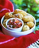 Wrinkled potates with salt and tomato salsa