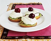 Kiwi fruit, low-fat soft cheese & cherries on sponge rounds