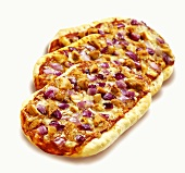 Small chicken and red onion pizzas